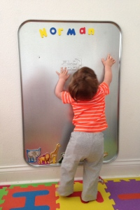 Baby Bear exploring his new magnet board.